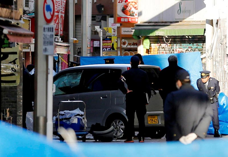 Policemen stand next to a car which plowed into pedestrians on New Year day in Tokyo, Japan, January 1, 2019. Photo: Reuters