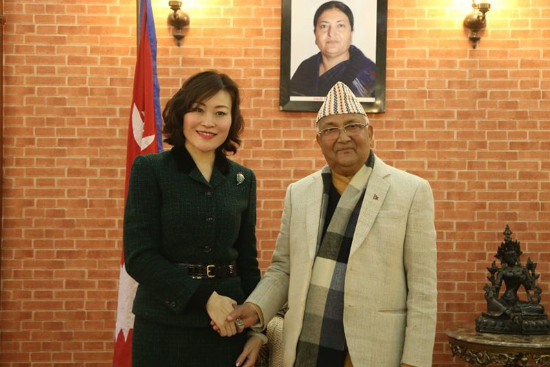 Newly appointed Ambassador of the People's Republic of China, Hou Yanqi shakes hand with Prime Minister KP Sharma Oli. Photo: MoFA