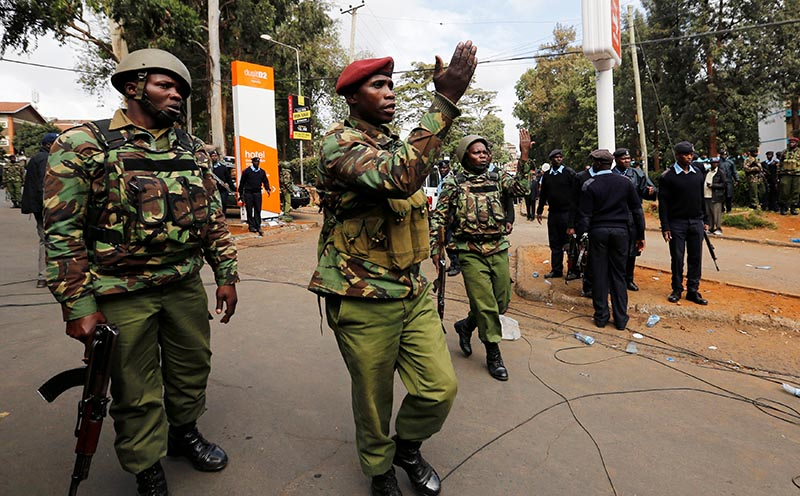 Kenyan policemen secure the street near the scene where explosions and gunshots were heard at the Dusit hotel compound, in Nairobi, Kenya January 16, 2019. Photo: Reuters