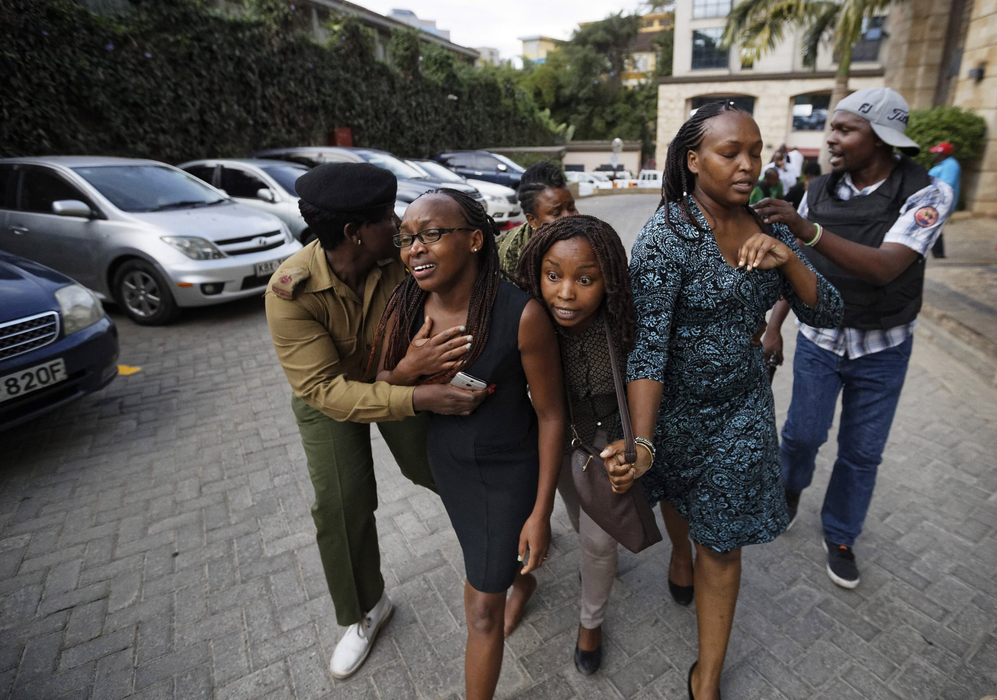 Civilians flee the scene at a hotel complex in Nairobi, Kenya on Tuesday, Jan. 15, 2019. Photo: AP