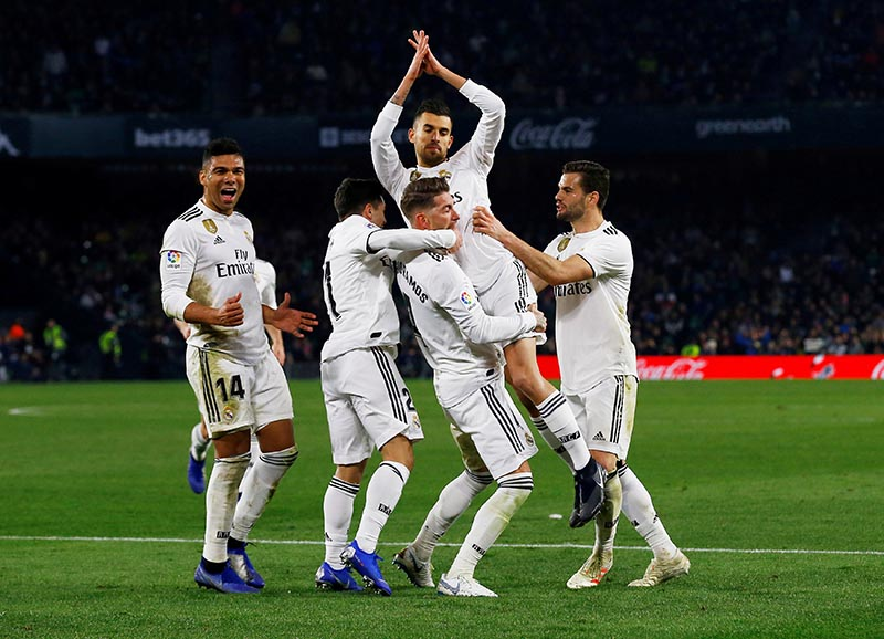 Real Madrid's Dani Ceballos celebrates with team mates after scoring their second goal during the La Liga Santander match between Real Betis and Real Madrid, at Estadio Benito Villamarin, in Seville, Spain, on January 13, 2019. Photo: Reuters
