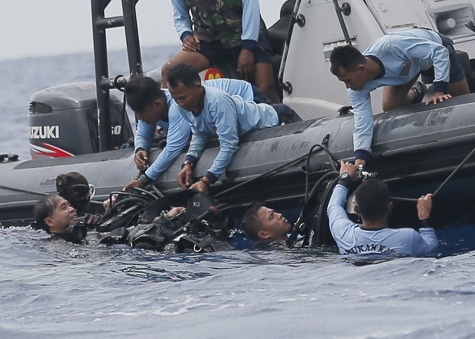 FILE - In this Oct. 30, 2018, file photo, Indonesian navy frogmen emerge from the water during a search operation for the victims of the crashed Lion Air plane in the waters of Tanjung Karawang, Indonesia. Photo: AP