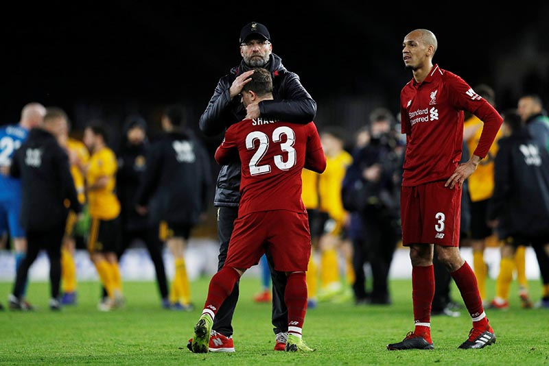 Liverpool manager Juergen Klopp, Xherdan Shaqiri and Fabinho react after the  FA Cup Third Round match between Wolverhampton Wanderers and Liverpool, at Molineux Stadium, in Wolverhampton, Britain, on January 7, 2019. Photo: Reuters
