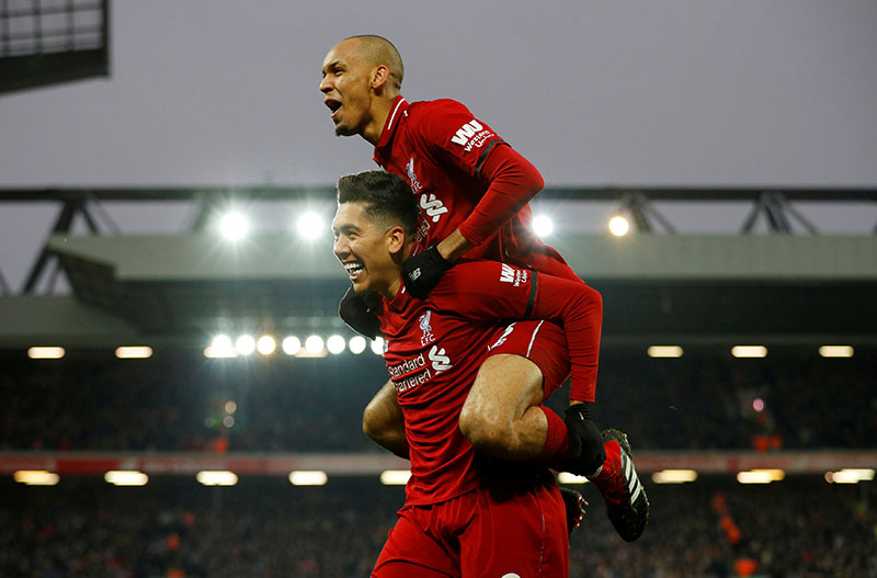 Liverpool's Roberto Firmino celebrates scoring their second goal with Fabinho during the Premier League match between Liverpool and Crystal Palace, at Anfield, in Liverpool, Britain, on January 19, 2019. Photo: Reuters