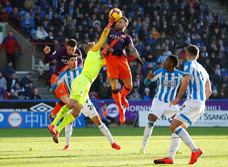 Huddersfield Town's Jonas Lossl in action with Manchester City's Nicolas Otamendi during the Premier League match between Huddersfield Town and Manchester City, at John Smith's Stadium, in Huddersfield, Britain, on January 20, 2019. Photo: Reuters