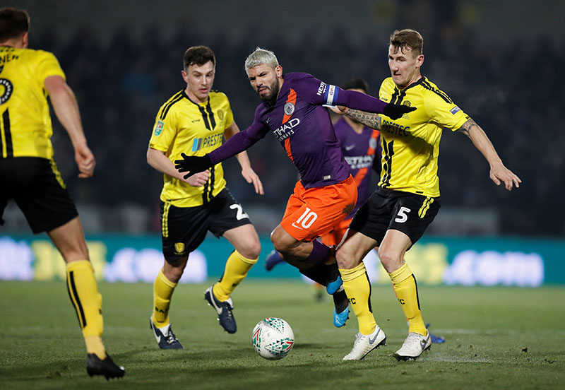 Manchester City's Sergio Aguero in action with Burton Albion's Kyle McFadzean during the Carabao Cup Semi-Final Second Leg match between Burton Albion and Manchester City, at Pirelli Stadium, in Burton-on-Trent, Britain, on January 23, 2019. Photo: Action Images via Reuters