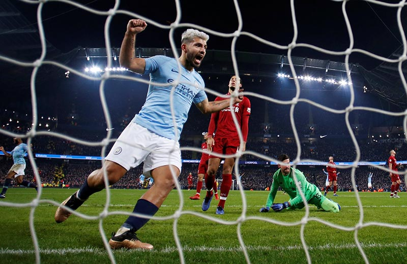 Manchester City's Sergio Aguero celebrates their second goal scored by Leroy Sane (not pictured) as Liverpool's Alisson and Virgil van Dijk look dejected during the  Premier League  match between Manchester City and Liverpool , at Etihad Stadium, in Manchester, Britain, on January 3, 2019. Photo: Reuters