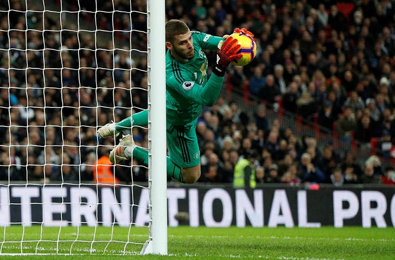 Manchester United's David de Gea makes a save from Tottenham's Harry Kane (not pictured) during the Premier League match between Tottenham Hotspur and Manchester United, at Wembley Stadium, in London, Britain, on January 13, 2019. Photo: Action Images via Reuters