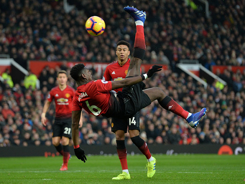 Manchester United's Paul Pogba shoots at goal during the  Premier League match between Manchester United and Brighton & Hove Albion, at Old Trafford, in Manchester, Britain, on January 19, 2019. Photo: Reuters