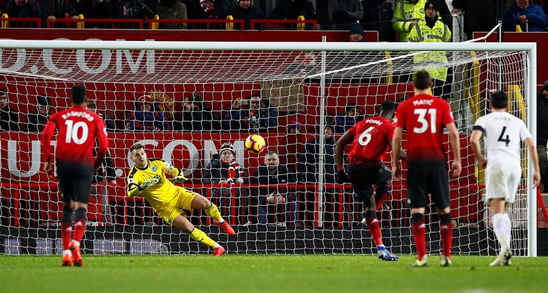 Manchester United's Paul Pogba scores their first goal from the penalty spot  during the Premier League match between Manchester United and Burnley, at Old Trafford, in Manchester, Britain, on January 29, 2019. Photo: Action Images via Reuters