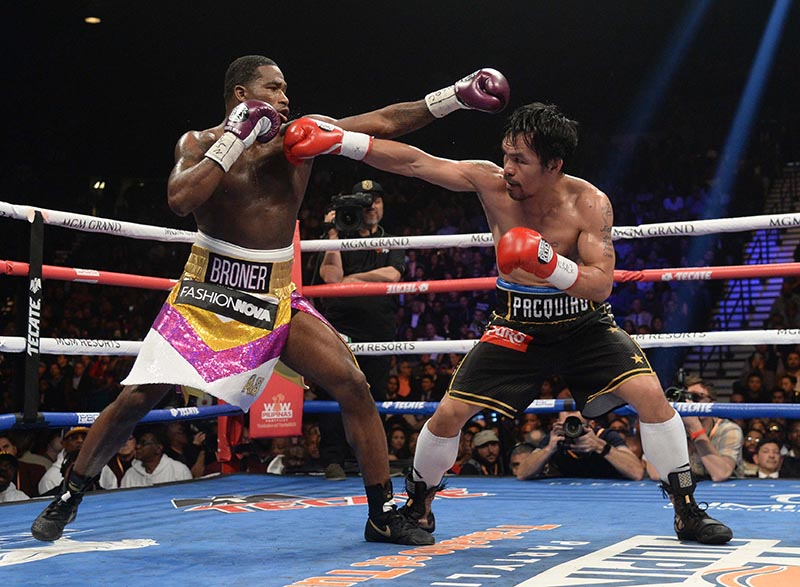 Manny Pacquiao (black trunks) and Adrien Broner (purple/silver trunks) box during a WBA welterweight world title boxing match at MGM Grand Garden Arena, in Las Vegas, NV, USA, on Jan 19, 2019. Photo: Joe Camporeale-USA TODAY Sports via Reuters