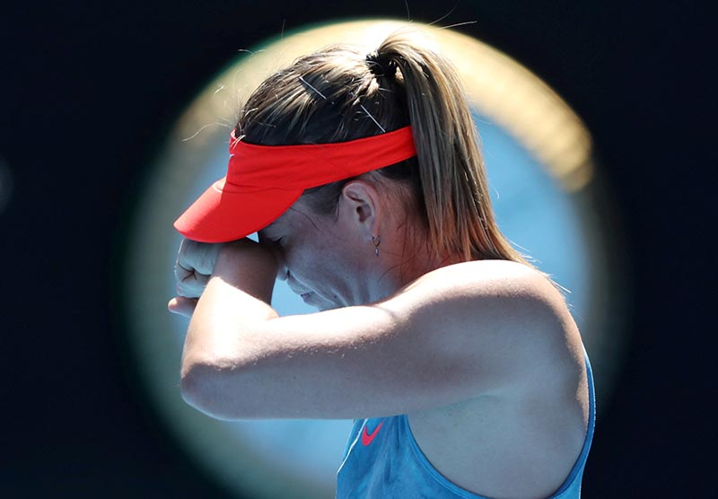Russia's Maria Sharapova reacts during the Australian Open Fourth Round match against Australia's Ashleigh Barty, at Melbourne Park, in Melbourne, Australia, on January 20, 2019. Photo: Reuters/ File