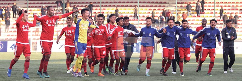 Players and officials of CMG Club Sankata celebrate after beating Ruslan Three Star Club in the Pulsar Martyrs Memorial A Division League match at the ANFA Complex grounds in Lalitpur on Wednesday. u00a0Photo: Udipt Singh Chhetry / THT