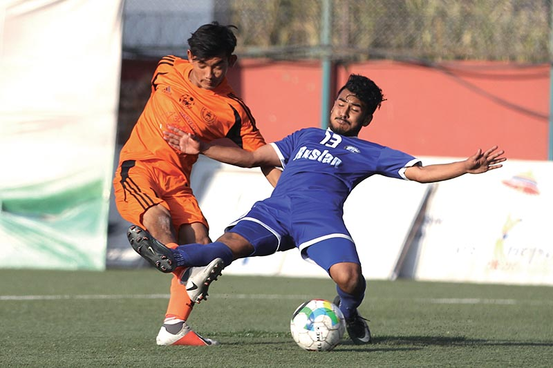 Action in the match between Himalayan Sherpa Club and Ruslan Three Star Club (right)during their Pulsar Martyrs Memorial A Division League match in Lalitpur on Sunday. Photo Courtesy: ANFA