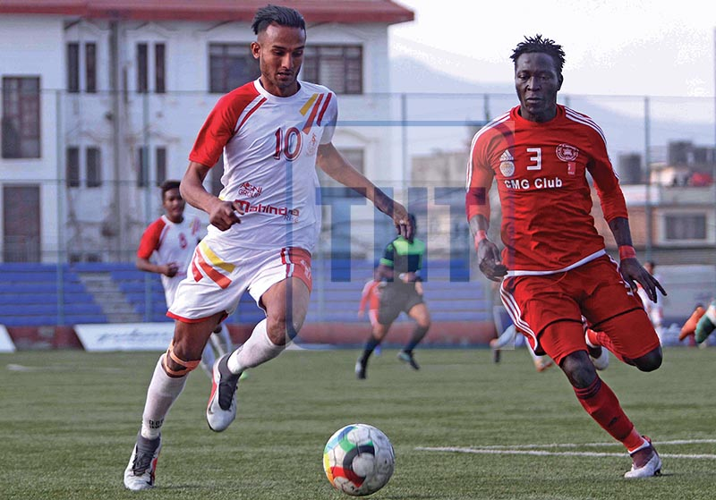 Yubraj Khadka (left) of Nepal APF Club andu00a0 Tampi Ernest of CMG Club Sankata vie for the ball during their Pulsar Martyrs Memorial A Division League match at the ANFA Complex grounds in Lalitpur on Monday. Photo: Udipt Singh Chhetry/ THT