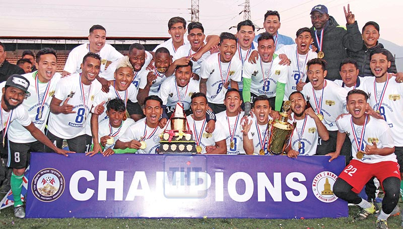 Players and officials of Manang Marsyangdi Club take group photo with winner's trophy and cash prize after prize distribution ceremony of Pulsar Martyr's Memorial 'A' Division League at ANFA ground in Lalitpur on Tuesday. Photo: Udipt Singh Chhetry/ THT
