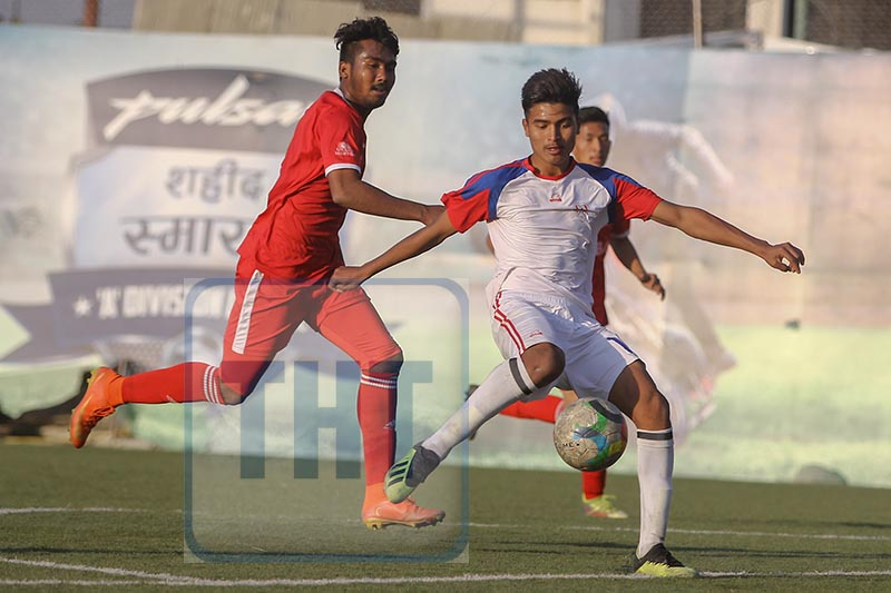 Player of Brigade Boys Club (right) and NIBL Friends Club vie for the ball during their Pulsar Martyrs Memorial A Division League match at the ANFA grounds in Lalitpur on Monday. Udipt Singh Chhetry / THT