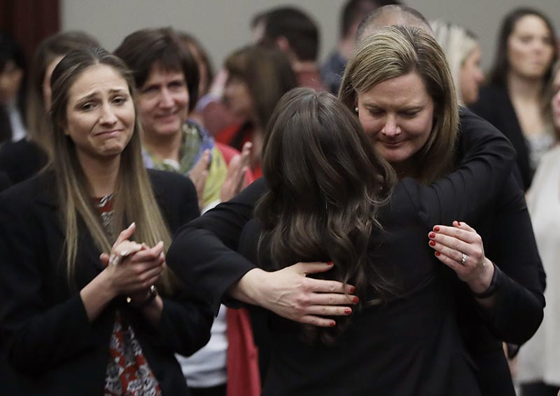 Victims react and hug Assistant Attorney General Angela Povilaitis after Larry Nassar was sentenced by Judge Rosemarie Aquilina to 40 to 175 years in prison during a sentencing hearing in Lansing, Mich., on Jan. 24, 2018. Photo: AP/ File