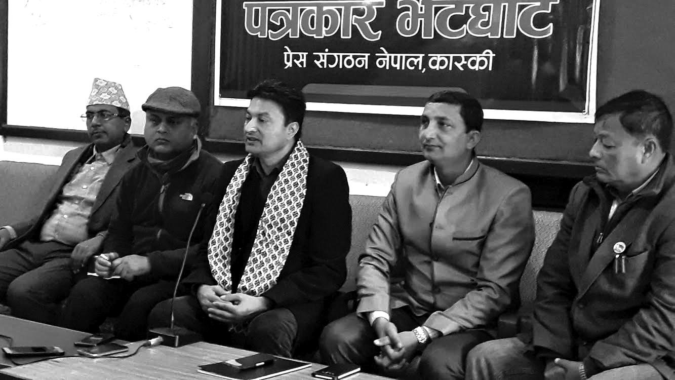 Minister of Labour, Employment and Social Security Gokarna Bista speaking at a programme, in Pokhara, on Saturday. Photo: THT