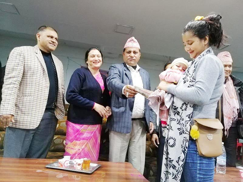Mayor Bhim Parajuli of Biratnagar metropolis handing over incentives to a mother for giving birth to a baby girl in Biratnagar metropolis office, Morang, on Monday, January 7, 2019. Photo: THT