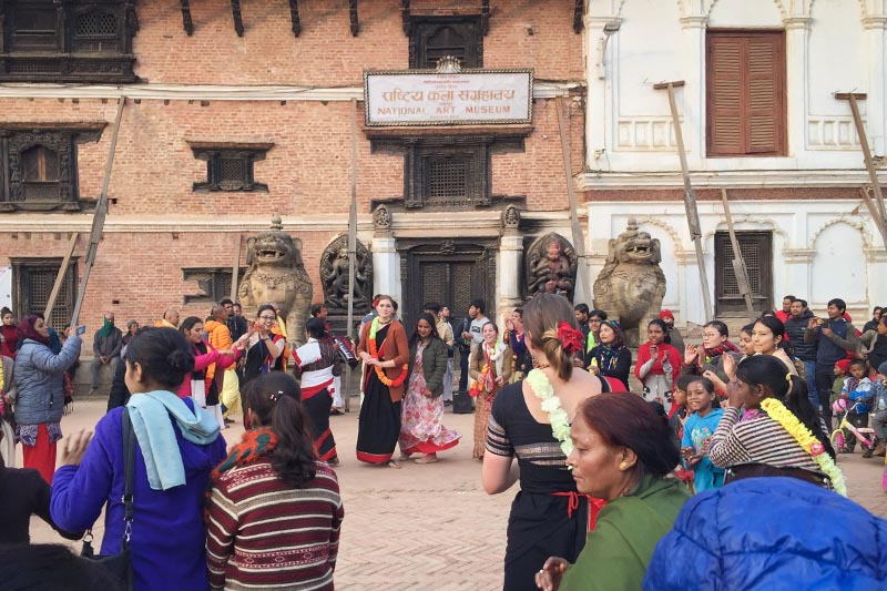 Locals, as well as tourists, perform a religious dance in front of the National Art Museum, in Bhaktapur, on Wednesday, January 16, 2019. Photo: Prawal Lamshal/THT