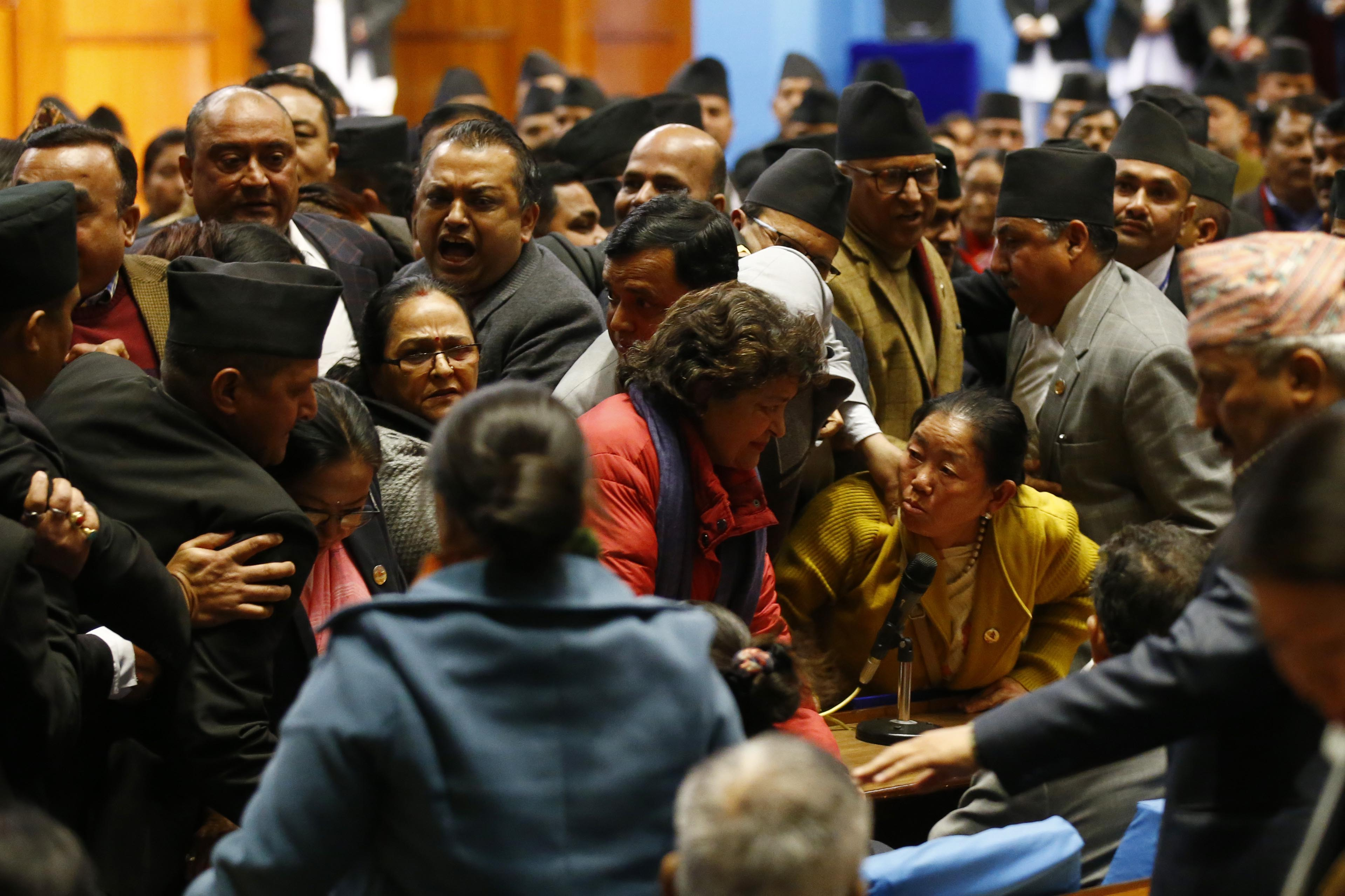 Nepali Congress lawmakers shouting slogans against the National Medical Education Bill in the well of the House of Representatives, in Kathmandu, on Friday, January 25, 2019. The House of Representatives (HoR) passed the National Medical Education Bill amid commotion. Photo: Skanda Gautam/THT