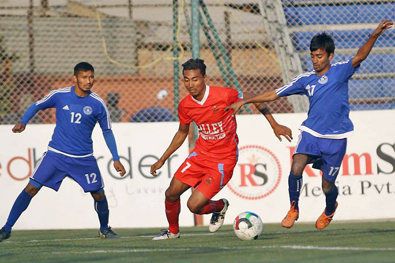 Players vie for a ball during their Pulsar Martyr's Memorial 'A' Division League in Kathmandu, on Tuesday, January 01, 2019. Photo: ANFA/facebook