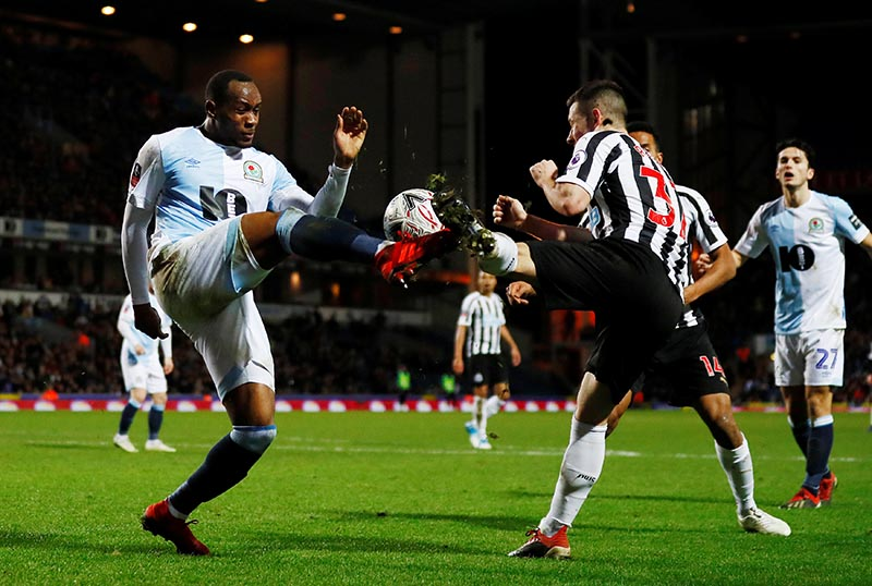 Blackburn Rovers' Ryan Nyambe in action with Newcastle United's Callum Roberts during the FA Cup Third Round Replay match between Blackburn Rovers and Newcastle United, at Ewood Park, Blackburn, on Britain, on January 15, 2019. Photo: Action Images via Reuters