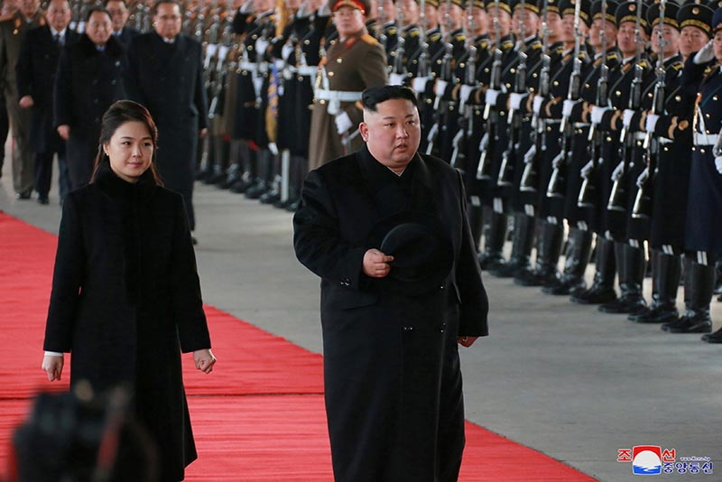 North Korean leader Kim Jong Un and wife Ri Sol Ju inspect an honour guard before leaving Pyongyang for a visit to China, this January 7, 2019 photo released by North Korea's Korean Central News Agency (KCNA) in Pyongyang January 8, 2019. Photo: KCNA via Reuters