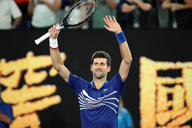 Serbia's Novak Djokovic celebrates after winning the match against France's Jo-Wilfried Tsonga. Photo: Reuters