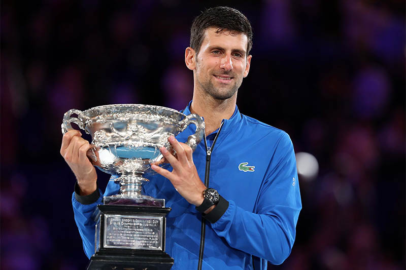 Serbia's Novak Djokovic poses with his trophy after winning the match against Spain's Rafael Nadal. Photo: Reuters