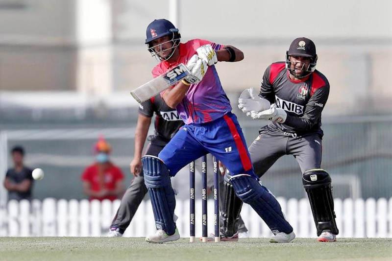 FILE: UAE's wicket keeper watches as Nepali batsman Paras Khadka plays a shot during ODI series in Dubai. Courtesy: NatSportUAE