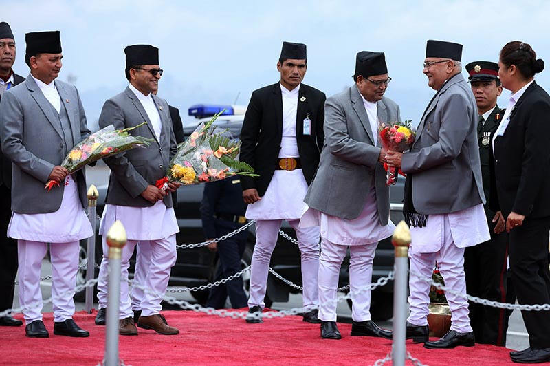 Prime Minister KP Sharma Oli being received by ministers upon his return from Switzerland after participating in the World Economic Forum at Tribhuvan International Airport, in Kathmandu, on Saturday. Photo: THT