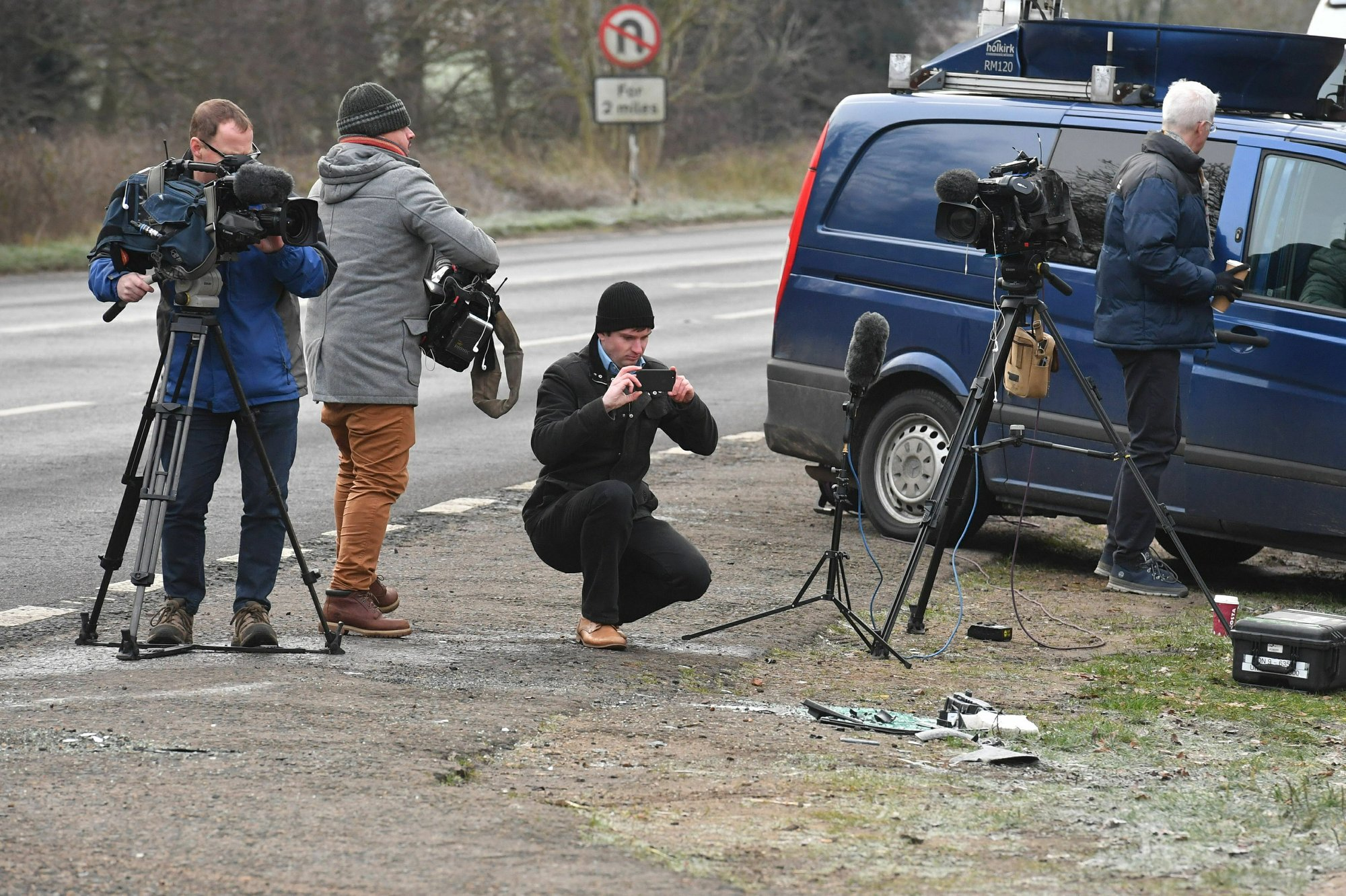 News media film broken glass and car parts on the road side near to the Sandringham Estate, England, where Prince Philip was involved in a road accident late Thursday while he was driving, on Friday Jan. 18, 2019. Photo: AP