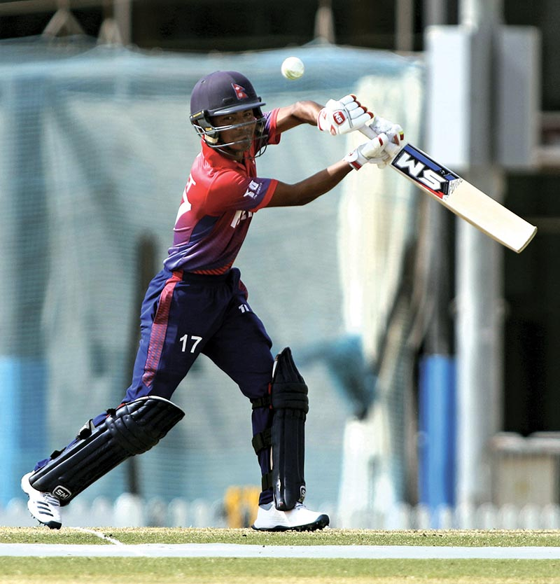 Rohit Paudel playing a shot against United Arab Emirates in the second game of the three-match ODI series in Dubai on Saturday. Photo Courtesy: CricketingNepal