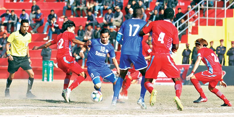 Rupesh KC of Ruslan Three Star Club (centre) tries to beat past a player from Valley Chyasal Youth Club during their quarter-final match of the third Nepal Ice International Farwest Khaptad Gold Cup at the Dhangadhi Stadium on Monday. Photo: THT