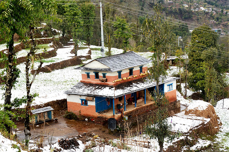 A view of a house and sorrounding areas after snowfall at Behu in Kathekhola Rural Municipality-5 of Baglung district, on Tuesday, January 29, 2019. Photo: RSS