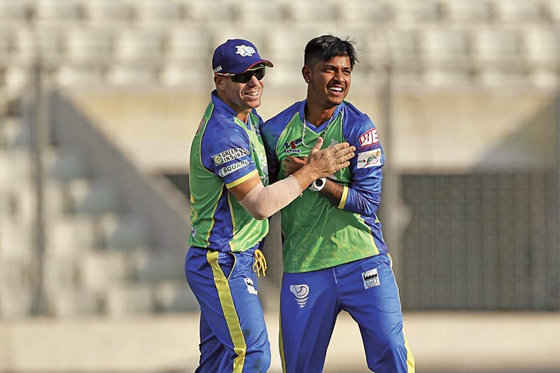 Sylhet Sixersu2019 David Warner and Sandeep Lamichhane celebrate a wicket against Comilla Victorians during their Bangladesh Premier League match in Dhaka on Sunday. Photo Courtesy: BCB