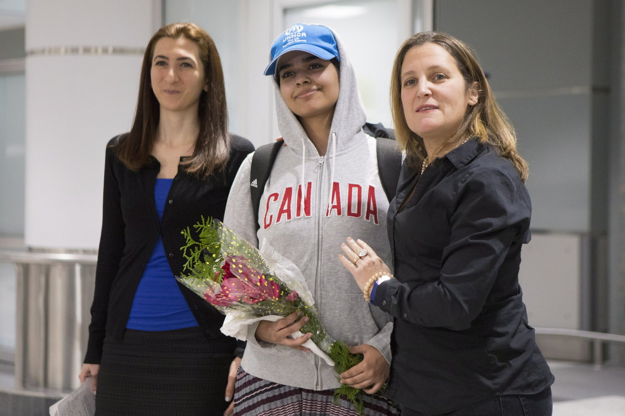 Rahaf Mohammed Alqunun, 18, center, stands with Canadian Minister of Foreign Affairs Chrystia Freeland, right, as she arrives at Toronto Pearson International Airport, on Saturday, Jan.12, 2019. Photo: AP