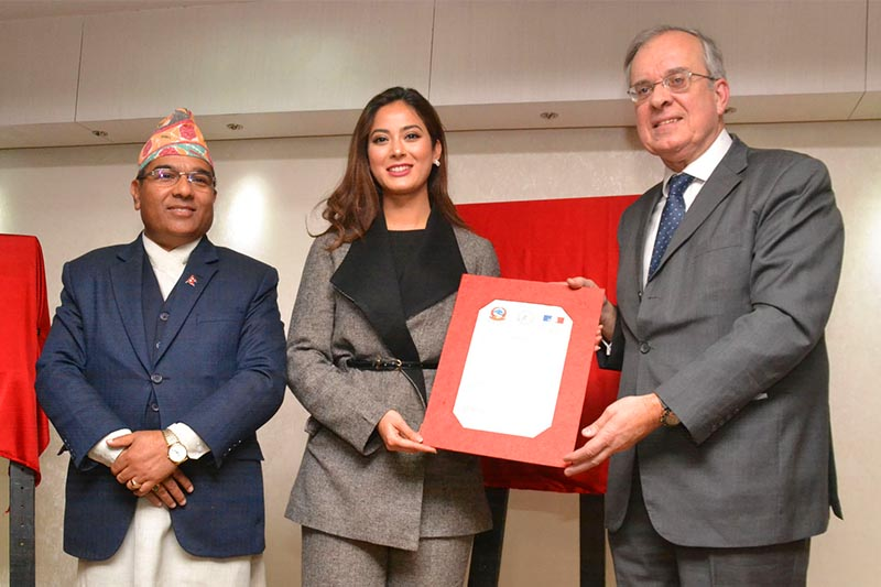 Secretary General of the French Ministry of Europe and Foreign Affairs Gourdault-Montagne (right) and Foreign Shankar Das Bairagi (left) jointly hand over the letter of appointment to Miss Nepal 2018 Shrinkhala Khatiwada, in Kathmandu, on Wednesday, January 9, 2019. Khatiwada was appointed the Goodwill Ambassador for the commemorative events marking the 70th anniversary of the establishment of diplomatic relations between Nepal and France. Photo: RSS