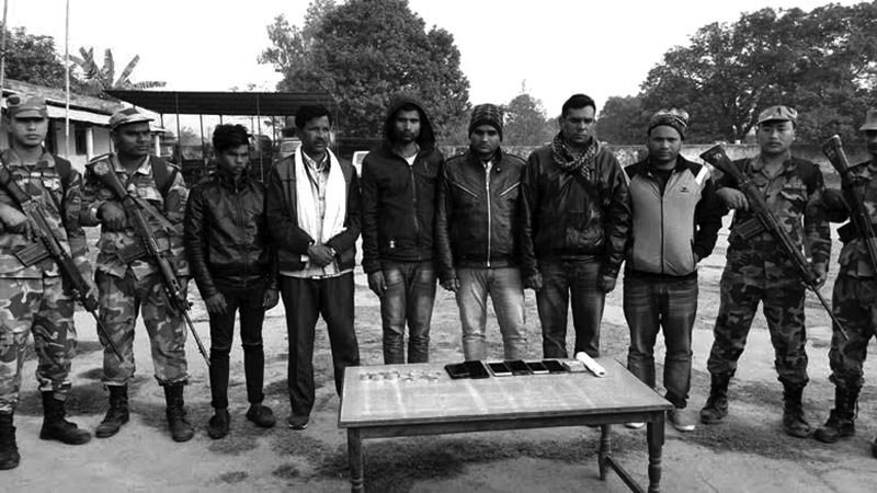 Persons arrested with illegal gold being made public, in Siraha, on Saturday. Photo: THT