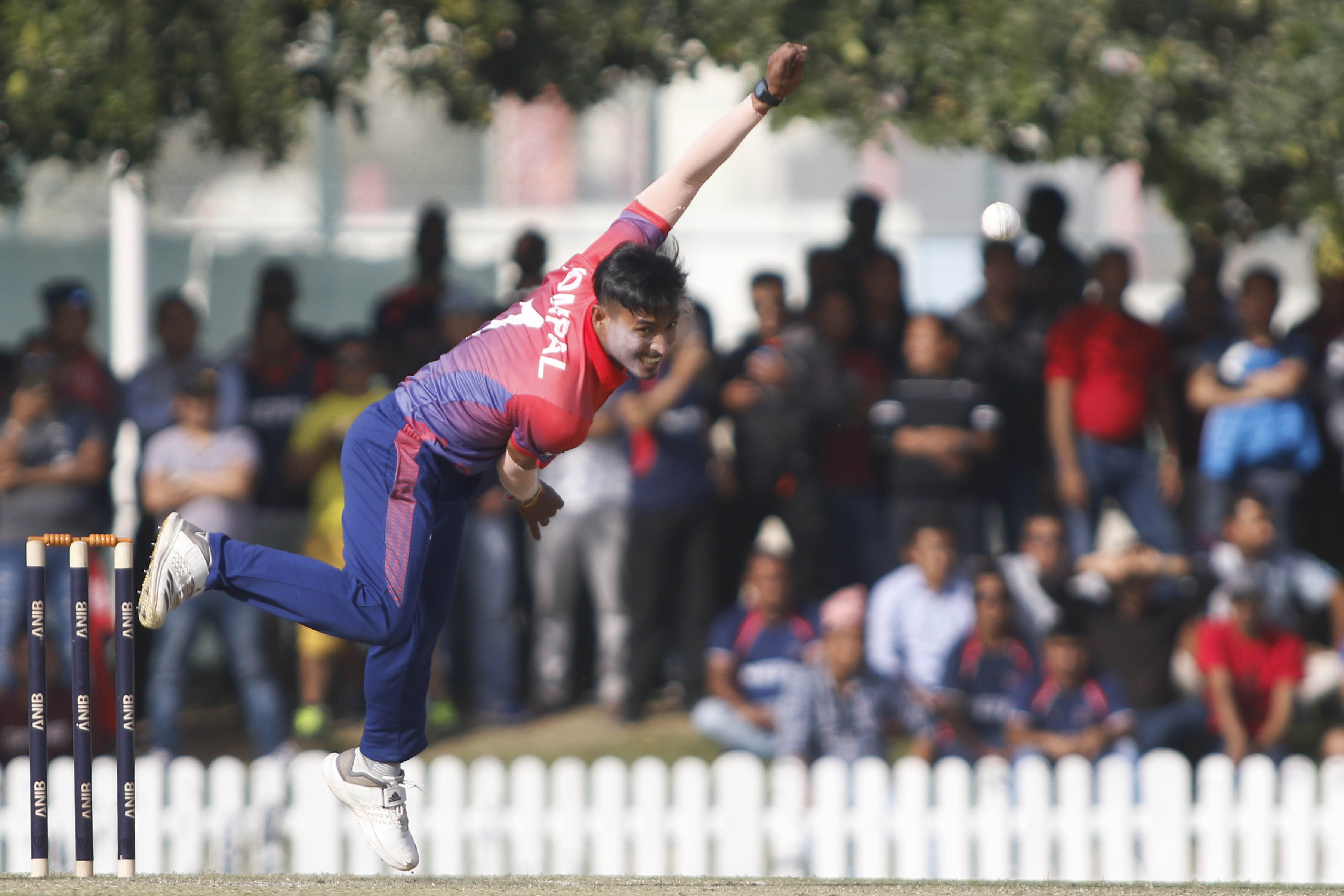 Nepalu2019s Sompal Kami bowls against the United Arab Emirates during their second game of the three-match ODI Series at the ICC Academy grounds in Dubai on Saturday. Nepal won the match by 145 runs.