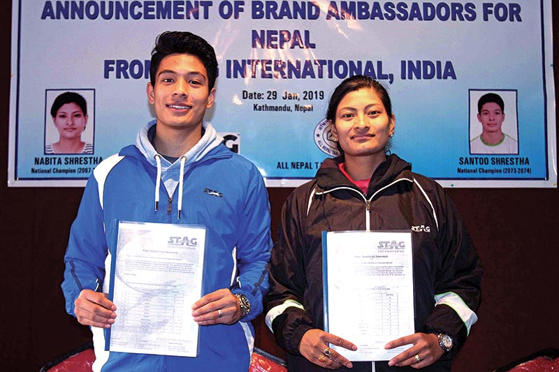 Stag International brand ambassadors Santoo Shrestha (left) and Nabita Shrestha hold their contract papers during a programme in Kathmandu on Tuesday. Photo: THT
