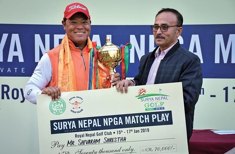 Shivaram Shrestha (left) receiving the trophy from Nepal PGA President Rabindra Man Shrestha after the Surya Nepal NPGA Match Play in Kathmandu on Thursday. Photo: THT