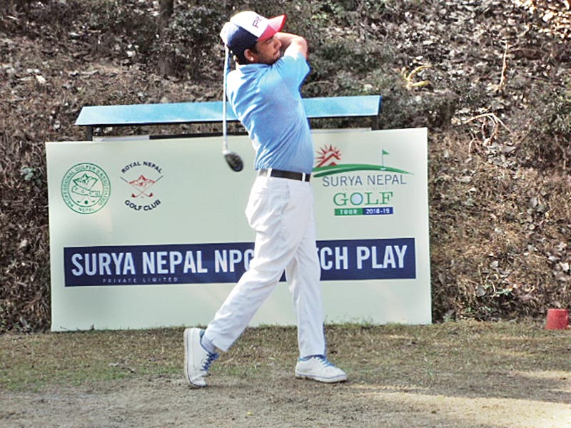 Dinesh Prajapati plays a shot against Dhana Bahadur Thapa during their first round match of the Surya Nepal NPGA Match Play at RNGC on Tuesday. Photo: THT