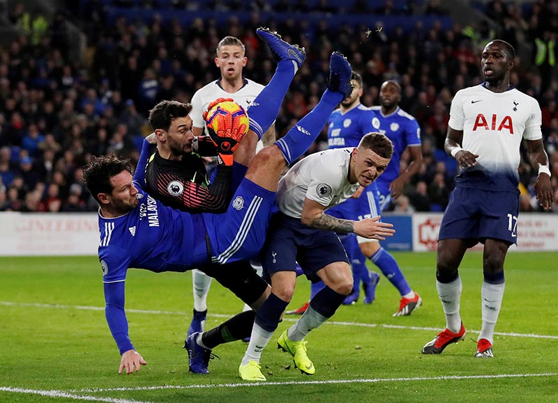 Cardiff City's Sean Morrison in action with Tottenham's Hugo Lloris and Kieran Trippier during the Premier League match between Cardiff City and Tottenham Hotspur, at Cardiff City Stadium, in  Cardiff, Britain, on January 1, 2019. Photo:  Action Images via Reuters