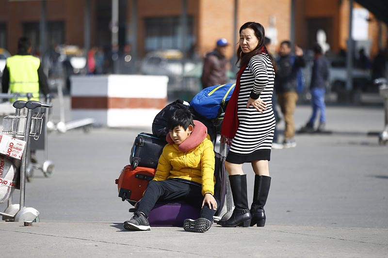 NOT A WALK IN THE PARK: A woman and a child arriving on international flights waiting for vehicles at the international terminal at Tribhuvan International Airport, in Kathmandu, on Sunday, January 13, 2019. Photo: Skanda Gautam/THT