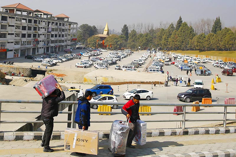 NOT A WALK IN THE PARK: Passengers arriving on international flights having to carry baggage as they walk towards the parking area at Tribhuvan International Airport, in Kathmandu, on Sunday, January 13, 2019. Photo: Skanda Gautam/THT