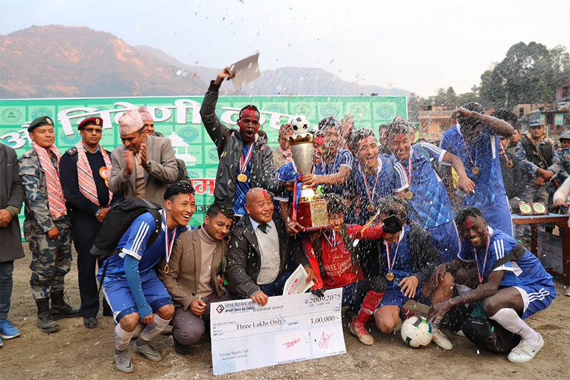 Triveni Youth Club players and officials celebrate after lifting the 27th Triveni Cup title in Besisahar of Lamjung district, on Friday, January 04, 2018. Photo: Ramji Rana