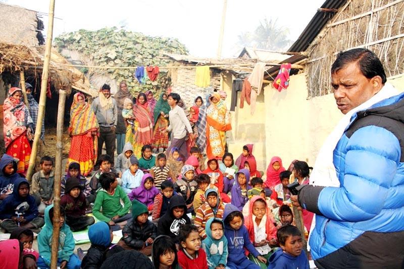 Former irrigation minister Umesh Yadav giving free tuition classes to Musahar children, in Rajbiraj Municipality, Saptari, on Friday, January 18, 2019. Photo: THT